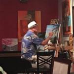 Lloyd Dobson Artist painting in studio